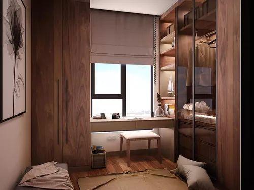 衣帽间选用了棕色的实木,呈现出一种有底蕴的高级质感.图片