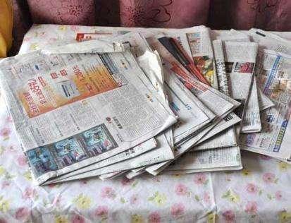 家里看过的旧报纸别急着扔,用处大着呢